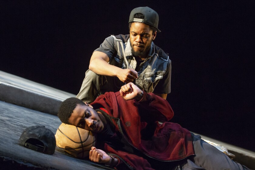 """This image released by Lincoln Center Theater shows Namir Smallwood, foreground, and Jon Michael Hill in a scene from """"Pass Over"""" in New York. Previews start Aug. 4, with an opening set for Sept. 4. (Jeremy Daniel/Lincoln Center Theater via AP)"""
