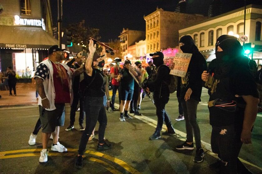 Demonstrators get into a heated argument with pedestrians.