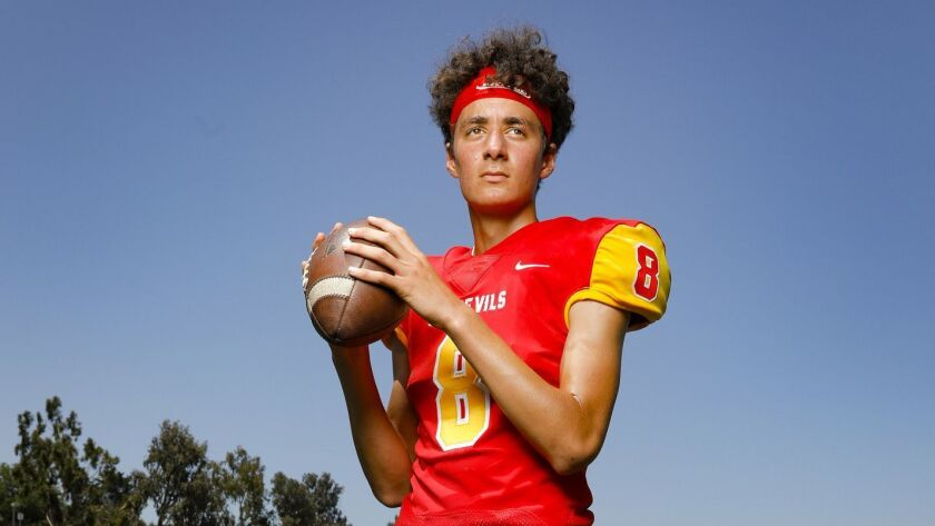 """Carson Taumoepeau, the quarterback on the football team, led Mt. Carmel with 15 points. """"This is how we do it,"""" said Taumoepeau. """"We give a 100 percent effort, play hard."""""""