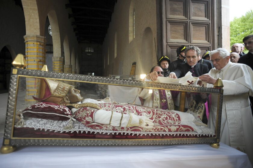 Pope Benedict XVI views the remains of Pope Celestine V in April 2009 at the 13th century Santa Maria di Collemaggio Basilica in L'Aquila, central Italy.