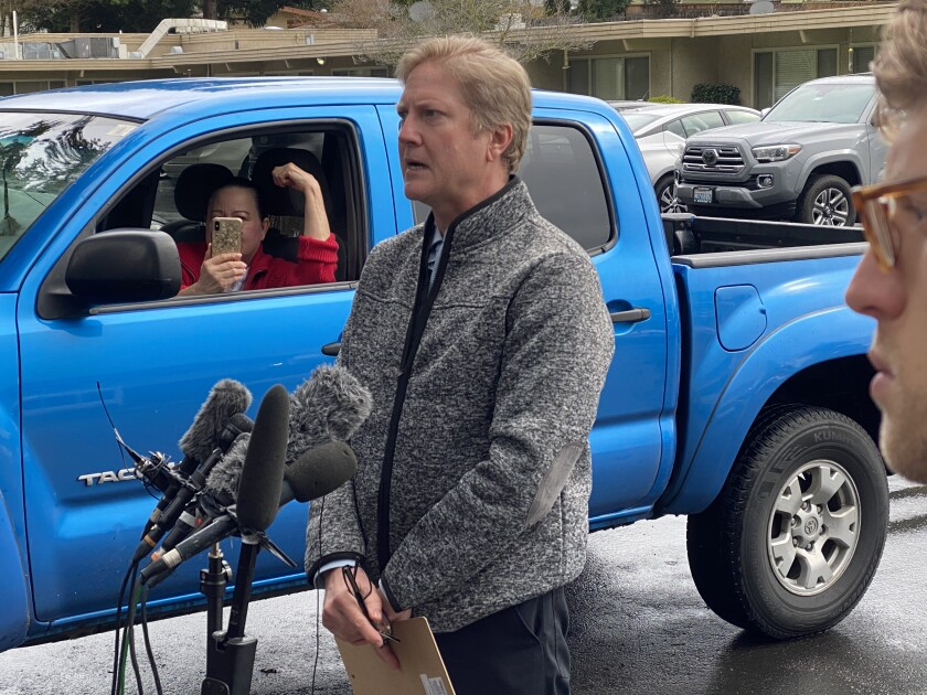 Timothy Killian, Life Care Center of Kirkland spokesman, speaks to reporters