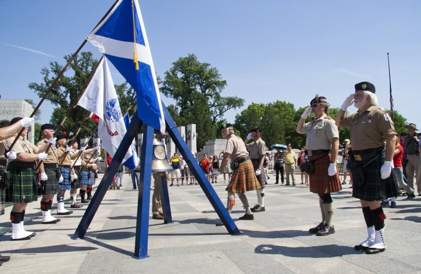 The Color Guard rings the bell at the Memorial Day ceremony inside the WWII memorial. Courtesy photo