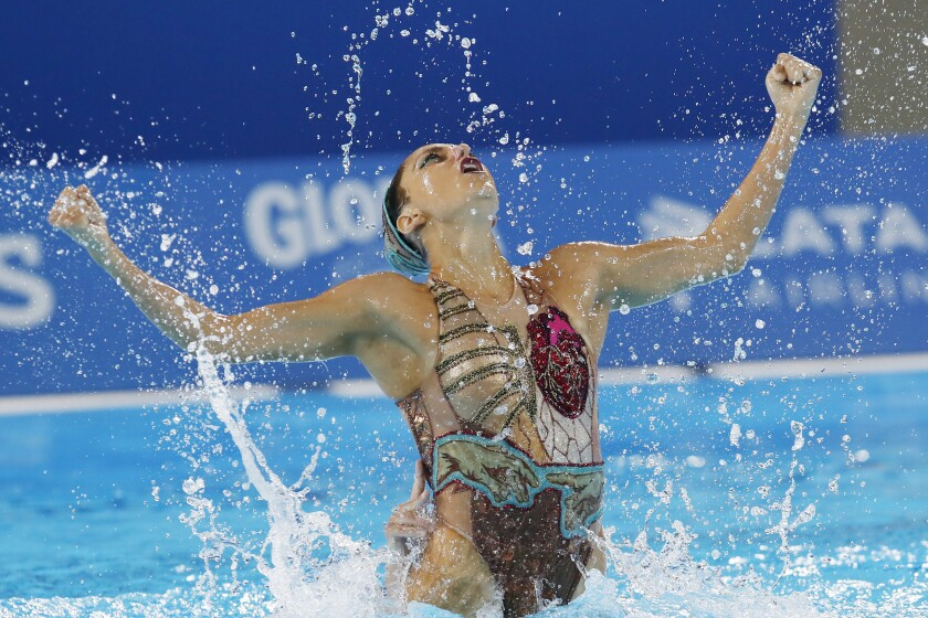 FILE - In this July 31, 2019, file photo, Ruby Remati of the United States competes in the artistic swimming duet technical routine final at the Pan American Games in Lima, Peru. Most Olympic athletes saw their preparations for Tokyo upended by the pandemic. But artistic swimmers were hit particularly hard. Closed borders, lockdowns and social distancing were alien concepts to athletes accustomed to being inches apart and, quite literally, in sync. (AP Photo/Moises Castillo, File)