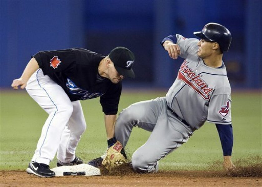 Toronto Blue Jays second baseman Aaron Hill, left, tags out Cleveland Indians' Grady Sizemore, right, on a steal attempt during the second inning of a baseball game in Toronto, on Tuesday, May 5, 2009. (AP Photo/The Canadian Press, Nathan Denette)