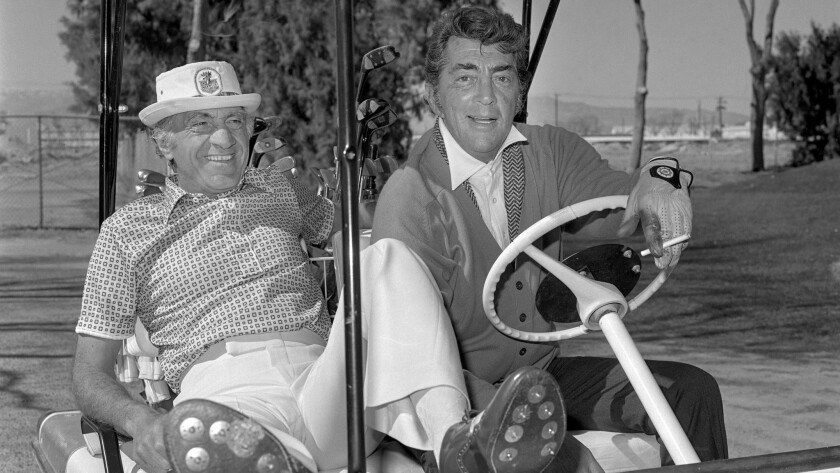 Taking a break from performing, Dean Martin (right) heads out to play golf at the old Desert Inn ho