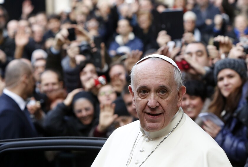 Pope Francis leaves Rome's Jesus Church on Friday after celebrating a mass with the Jesuits.