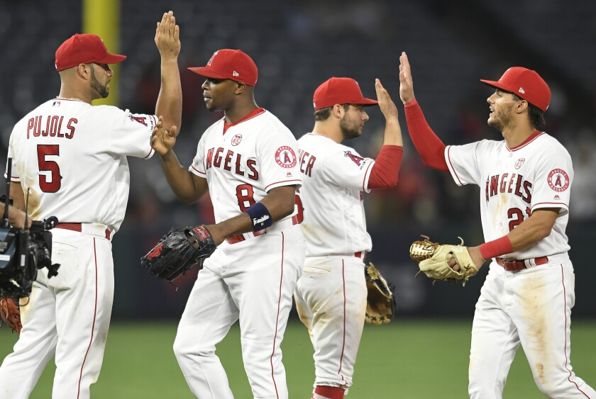 ANAHEIM, CA - JULY 15: Albert Pujols #5, Justin Upton #8, David Fletcher #6 and Michael Hermosillo celebrate a 9-6 win over the Houston Astros at Angel Stadium of Anaheim on July 15, 2019 in Anaheim, California. (Photo by John McCoy/Getty Images) ** OUTS - ELSENT, FPG, CM - OUTS * NM, PH, VA if sourced by CT, LA or MoD **
