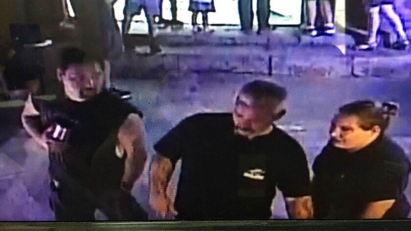 A frame grab released by the San Antonio Aquarium shows three suspects in the theft of a horn shark from an interactive exhibit.
