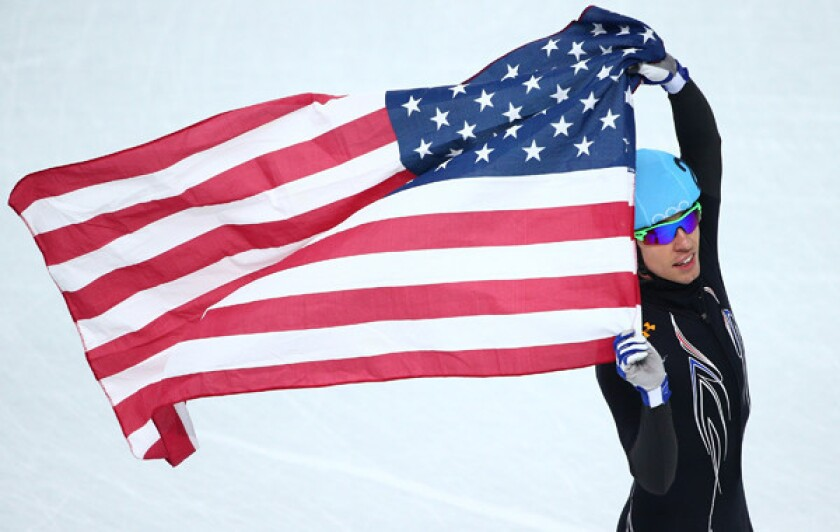 American Jordan Malone celebrates his team's silver-medal finish in the 5,000-meter short-track speedskating relay at the Sochi Winter Olympic Games on Friday.