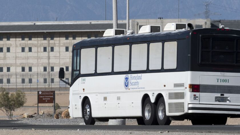 Homeland Security buses enter the Federal Correctional facility in Victorville, Calif., on Friday, J
