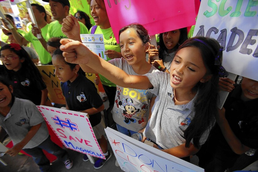 Makayla Bigler, 8, left, and Breeana Alano, 7, both going into the third grade, join a protest against the Los Angeles Unified School District's plan to shut down two charter schools.