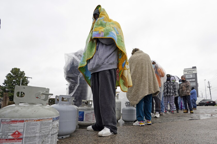 Carlos Mandez waits in line to fill his propane tanks