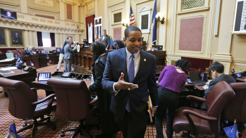 Virginia Lt. Gov. Justin Fairfax exits the floor after the Virginia State Senate adjourned their 2019 session at the Capitol in Richmond, Va., on Sunday.