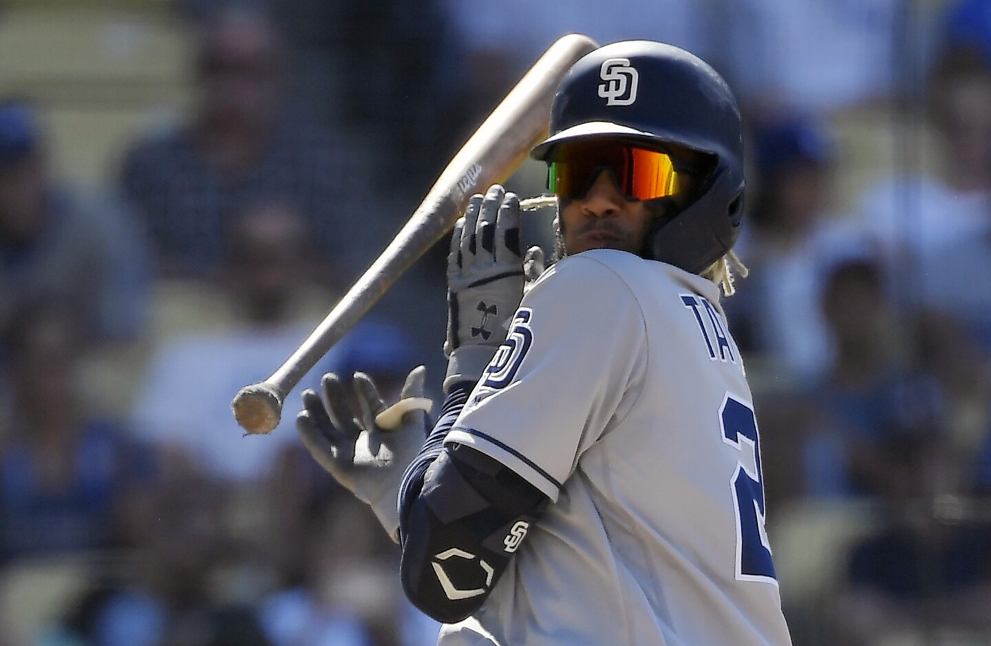 San Diego Padres' Fernando Tatis Jr. avoids a close pitch during the seventh inning of a baseball game against the Los Angeles Dodgers, Sunday, Aug. 4, 2019, in Los Angeles. (AP Photo/Mark J. Terrill)