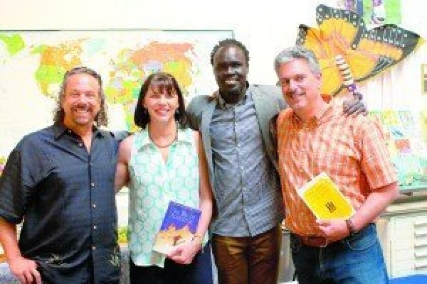 Author Jeff Salz, Fair Trade Décor co-owner Betsy Paganelli, author Alepho Deng and Fair Trade Décor co-ower Jude Paganelli at the first anniversary event.