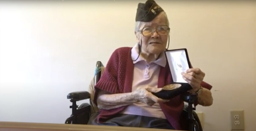 In this image from House Television video, 1st Lt. Elsie Chin Yuen Seetoo, accepts a Congressional Gold Medal during a virtual ceremony broadcast from Capitol Hill in Washington, Wednesday, Dec. 9, 2020. Seventy-five years after World War II ended, Congress is honoring thousands of Chinese Americans who served the United States in the war, earning citations for heroism despite institutional discrimination that included limits on how many Chinese people were allowed in the U.S. Nearly 20,000 people of Chinese ancestry served in the U.S. military during World War II, including about 40 percent who were not U.S. citizens due to laws such as the Chinese Exclusion Act, which made it illegal for Chinese laborers to immigrate to the U.S. and limited the Chinese population in the U.S. for more than 60 years. (House Television via AP)