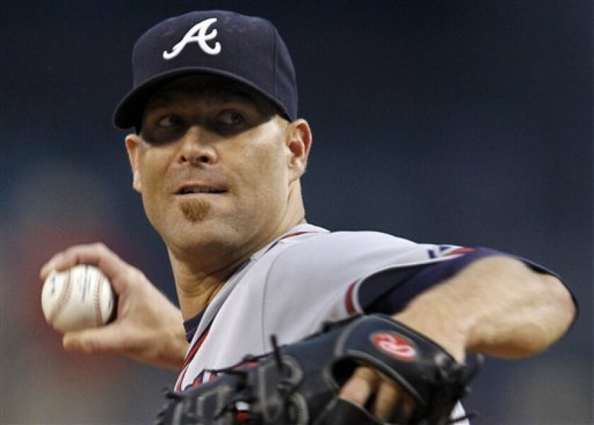 Atlanta Braves pitcher Tim Hudson throws in the first inning during a baseball game against the Pittsburgh Pirates in Pittsburgh on Tuesday, Sept. 7, 2010. (AP Photo/Gene J. Puskar)
