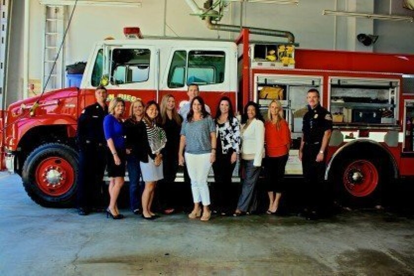 Kilroy Realty staff took a tour of Carmel Valley's Station 24 with far left, Battalion Chief David Gerboth and far right, San Diego Fire Rescue Department Assistant Fire Chief Brian Fennessy. Courtesy photos