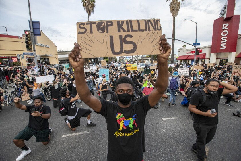 Hundreds of protestors march numerous blocks demonstrating against police brutality and the death of George Floyd.