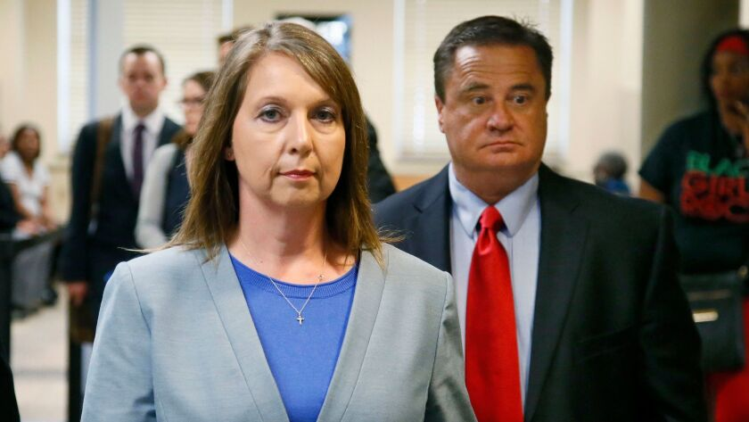 Betty Jo Shelby leaves court with her husband, Dave Shelby, after the jury in her case began deliberations in Tulsa, Okla.
