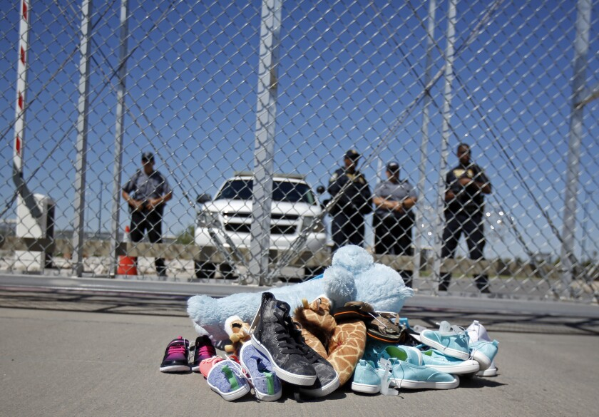 Shoes and a teddy bear, brought by a group of U.S. mayors, are piled up outside a holding facility for immigrant children in Tornillo, Texas, near the Mexican border on June 21, 2018.