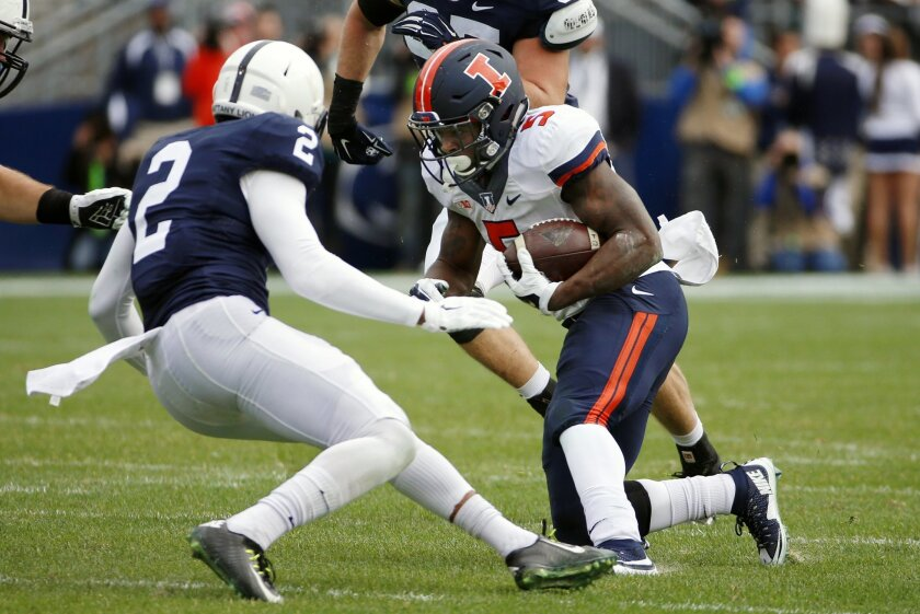Illinois running back Ke'Shawn Vaughn (5) carries the ball during the first half of an NCAA college football game with Penn State safety Marcus Allen (2) defending in State College, Pa., Saturday, Oct. 31, 2015. (AP Photo/Gene J. Puskar)