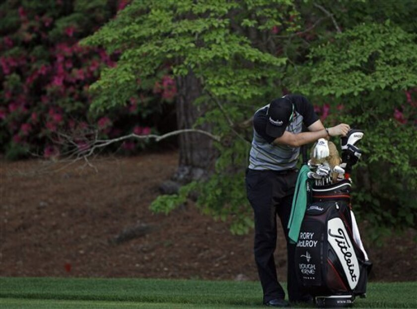 Rory McIlroy of Northern Ireland leans on his golf bag on the 13th hole during the final round of the Masters golf tournament Sunday, April 10, 2011, in Augusta, Ga. (AP Photo/Matt Slocum)