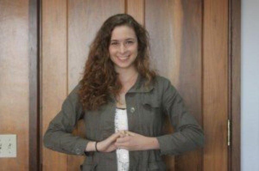 Lindsey Young, a La Jolla High School senior who will play Princess Fiona in 'Shrek The Musical,' strikes what she calls her 'Disney Princess Pose.' Ashley Mackin