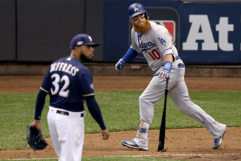Justin Turner watches his two-run homer in Game 2.
