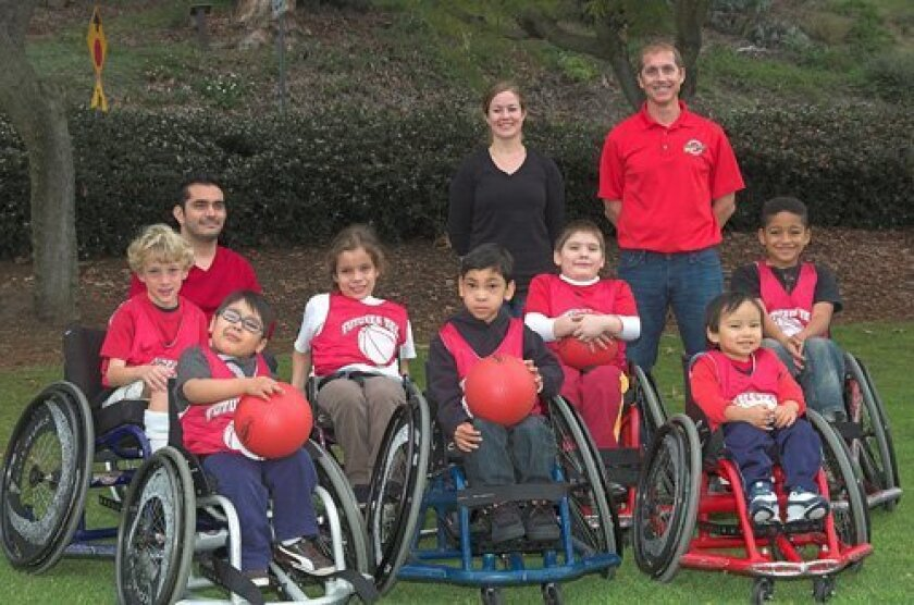 Carmel Valley's Jon Richards (standing, right) with an Adaptive Sports and Recreation Association basketball team.