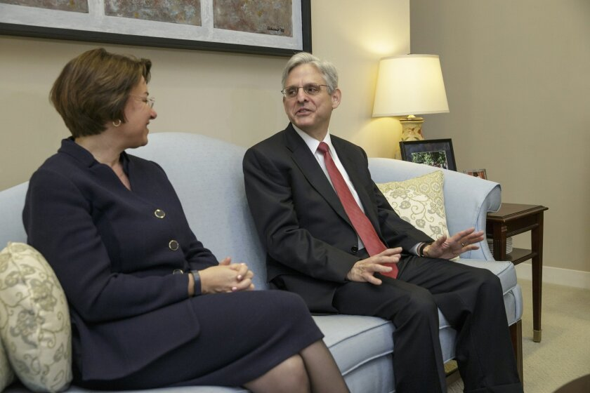 Sen. Amy Klobuchar, D-Minn., left, a Senate Judiciary Committee member, the committee that considers judicial nominations, meets with Judge Merrick Garland, President Barack Obama's choice to replace the late Justice Antonin Scalia on the Supreme Court, Wednesday, March 23, 2016, on Capitol Hill in Washington. (AP Photo/J. Scott Applewhite)