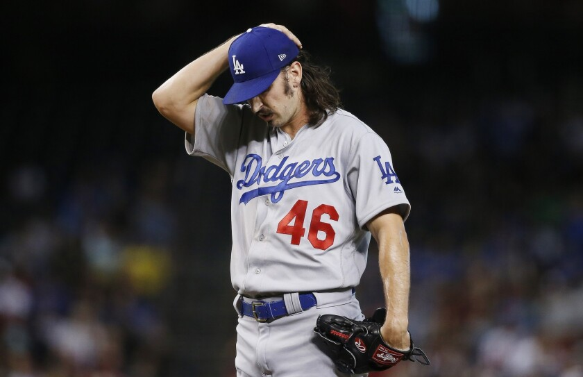 Dodgers starting pitcher Tony Gonsolin pauses on the mound during a game against the Arizona Diamondbacks on June 26.
