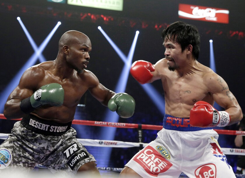 Manny Pacquiao, right, trades blows with Timothy Bradley during their WBO welterweight title on April 12, 2004.