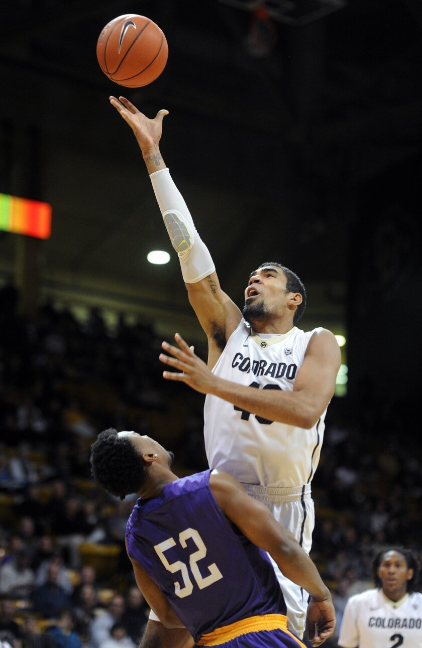 Colorado's Josh Scott drives to the basket over Liscomb's Malcolm Smith during an NCAA college basketball game, Sunday, Nov. 30, 2014, in Boulder. (AP Photo/The Daily Camera, Cliff Grassmick) NO SALES