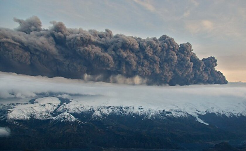 Smoke and steam hangs over the volcano under the Eyjafjallajokull glacier in Iceland, Wednesday April 14, 2010.