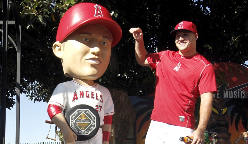 Los Angeles Angels' Mike Trout smiles after unveiling a life-sized bobblehead doll before a baseball game against the Texas Rangers on Friday.