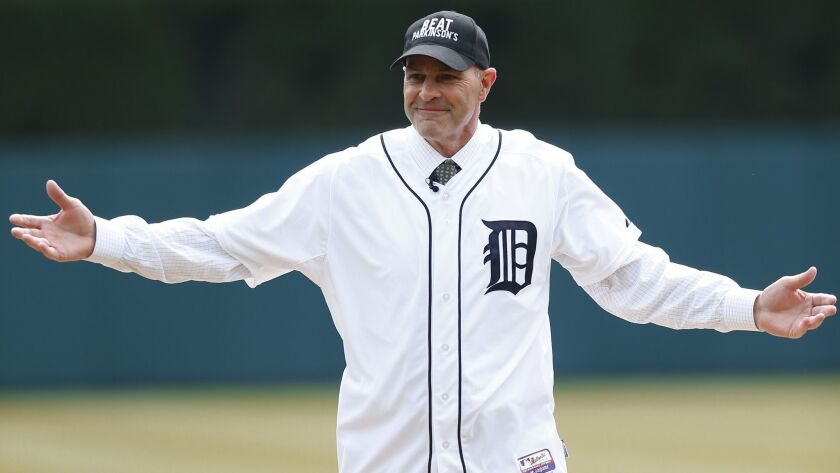 Kirk Gibson reacts after throwing a ceremonial pitch before an opening day baseball game between the New York Yankees and Detroit Tigers on April 8, 2016, in Detroit.