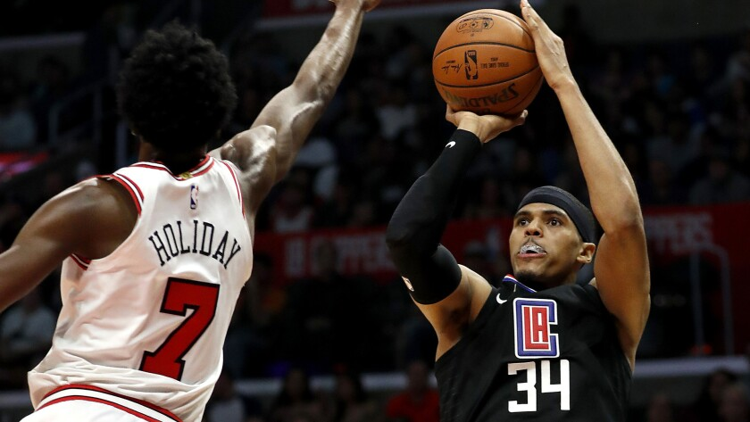 LOS ANGELES, CALIF. - FEB. 3, 2018. Clippers forward Tobias Harris shoots over Bulls guard Justin
