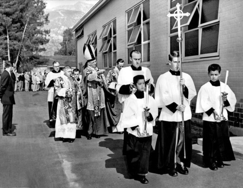 Archbishop J. Francis McIntyre, flanked by the Rev. Patrick Coleman, left, and the Rev. James R. Mulcahy, blesses the school at Assumption of the Blessed Virgin Mary Church in Pasadena. The Rev. Benjamin Hawkes is seen in the foreground, ahead of the archbishop.