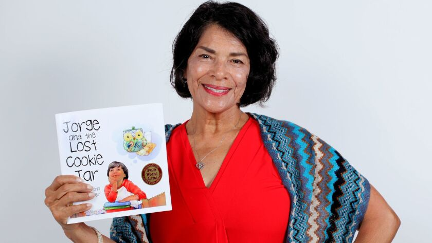 """Author Marta Arroyo with her latest book, """"Jorge and the Lost Cookie Jar."""""""