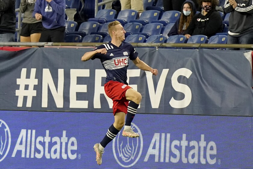 New England Revolution's Adam Buksa celebrates after scoring against the Columbus Crew in the second half of an MLS Soccer match, Sunday, May 16, 2021, in Foxborough, Mass. (AP Photo/Steven Senne)