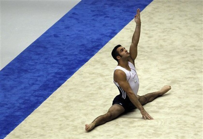 USA's Danell Leyva performs the floor exercise during the men's qualifying of the Artistic Gymnastics World Championships in Tokyo, Japan, Sunday, Oct. 9, 2011. (AP Photo/Bullit Marquez)