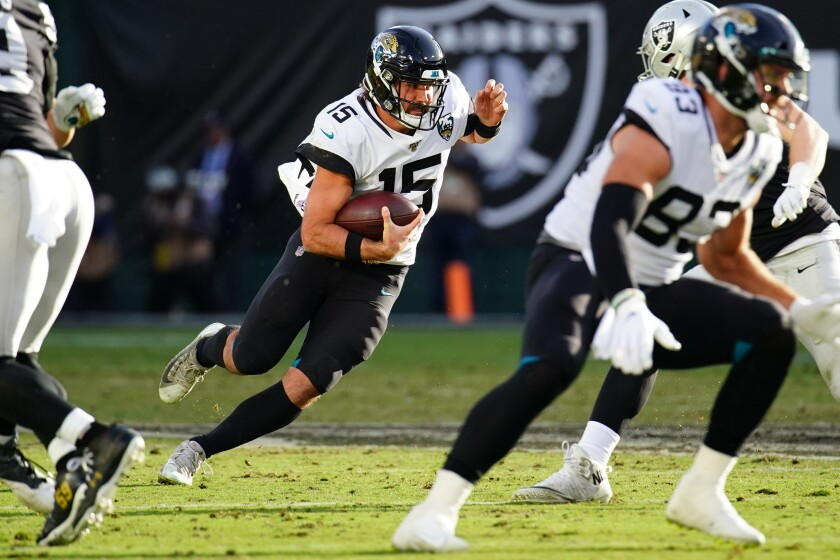 Jacksonville Jaguars quarterback Gardner Minshew runs with the ball during a win over the Oakland Raiders on Sunday.