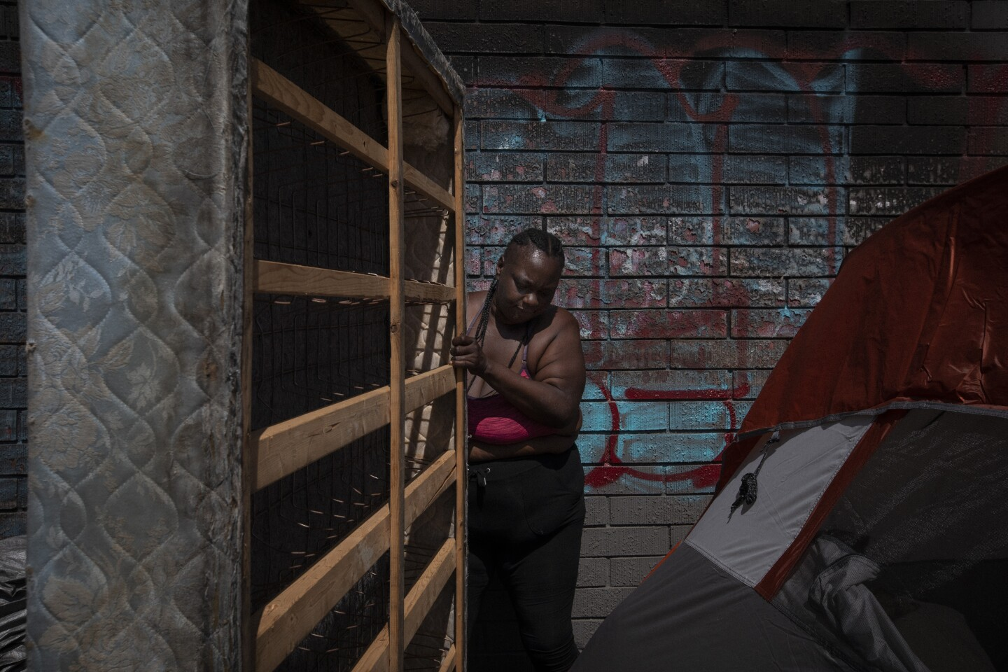 LOS ANGELES, CA JUNE 26, 2018: Leneace Pope, known as ÒNiecyÓ for short moves her mattress into her tent near West 39th Street and South Broadway in Los Angeles, CA June 26, 2018. (*Editors Note: Contact photo editor Mary Cooney should you have any questions. Please do not use this image for other stories. This image is for a future project by writer Tom Curwen.) (Francine Orr/ Los Angeles Times)