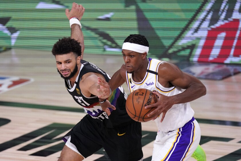 Denver Nuggets' Jamal Murray has the ball stripped away by Lakers guard Rajon Rondo.