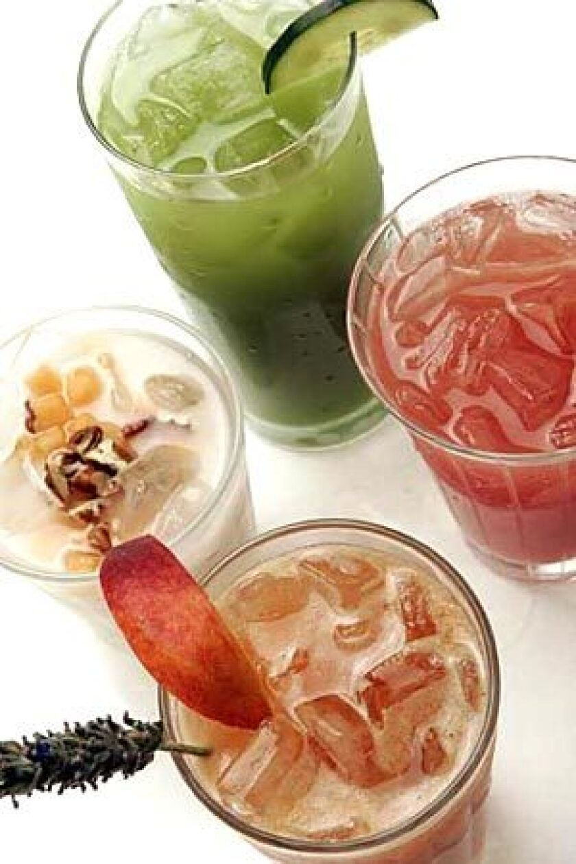 JUICE BAR: Natural summer coolers, clockwise from top: cucumber-lime, watermelon-lime, peach-lavender, and the classic horchata.