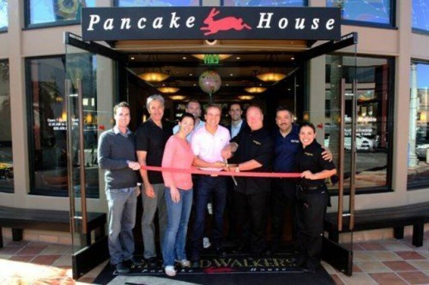 Richard Walker's Pancake House has opened at 909 Prospect St. Pictured are (l to r) Timmy Sullivan, Mark Bausbeck, Michelle Jarka, Chris Clark, owner RichardWalker Jr., RJ Sharp, Richard Walker Sr., Ray Ovall and Gema Ramirez. Leon Chow