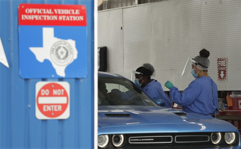 COVID-19 antibody and diagnostic testing are administered at a converted vehicle inspection station Tuesday in San Antonio.
