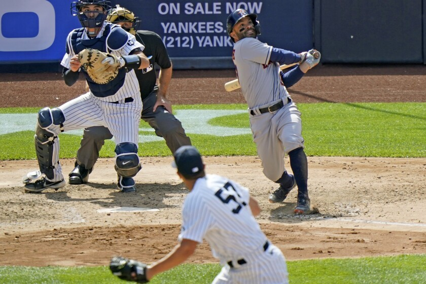 New York Yankees relief pitcher Chad Green (57) follows through as Houston Astros' Jose Altuvé (27) and Yankees catcher Kyle Higashioka (66) watch Altuvé's three-run home run during the eighth inning of a baseball game, Thursday, May 6, 2021, at Yankee Stadium in New York. Home plate umpire Dan Iassogna, second from left, looks on. (AP Photo/Kathy Willens)