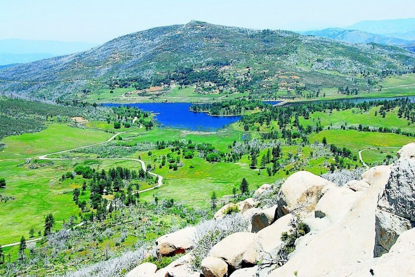 Highway 79 winds through Cuyamaca Rancho State Park to reach Lake Cuyamaca, seen here from atop Stonewall Peak. North Peak rises behind Lake Cuyamaca CREDIT: priscilla lister